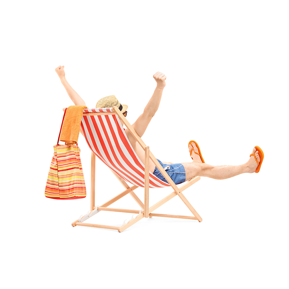 Happy young male on a beach chair gesturing happiness isolated on white background